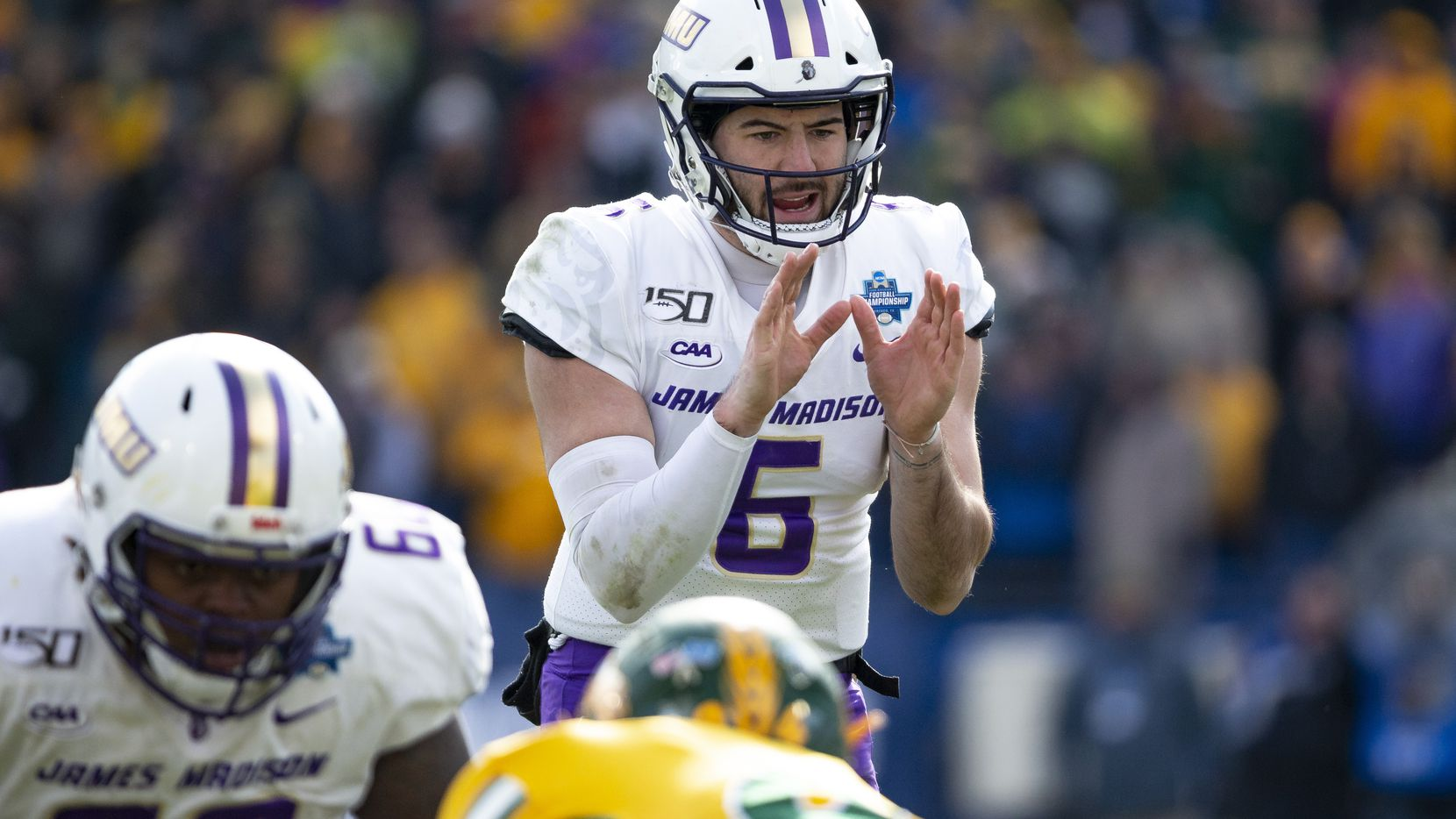 James Madison quarterback Ben DiNucci (6) waits for the ball to be snapped during the second half of the FCS championship NCAA college football game against North Dakota State, Saturday, Jan. 11, 2020, in Frisco, Texas. (AP Photo/Sam Hodde)