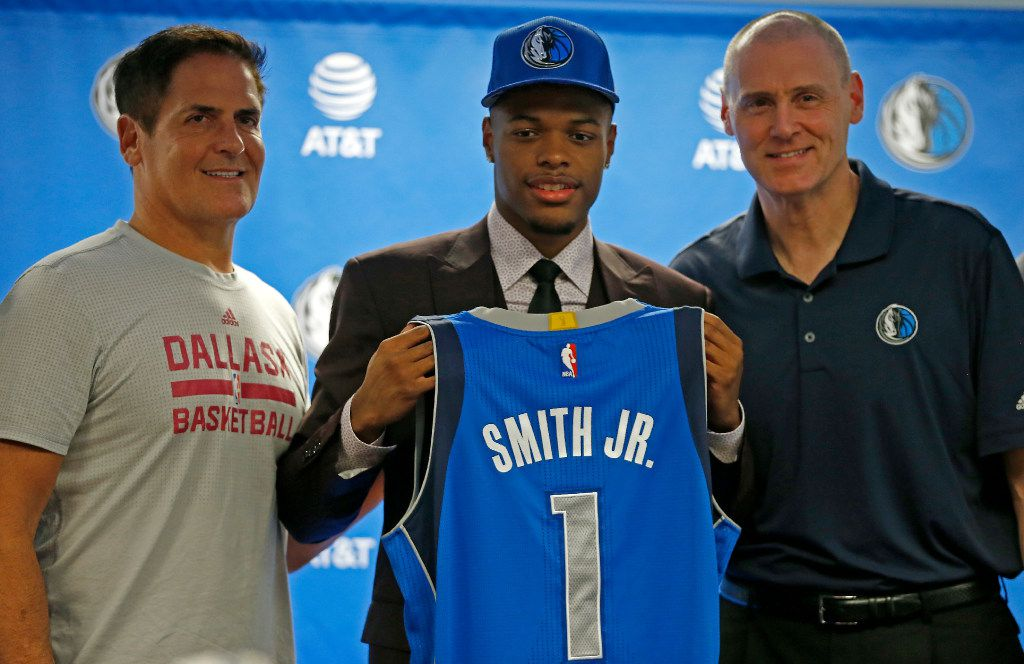 Mavericks first round pick Dennis Smith Jr. (center) poses for a photograph with Head Coach Rick Carlisle (right) and owner Mark Cuban during a press conference at American Airline Center in Dallas, Friday, June 23, 2017. (Jae S. Lee/The Dallas Morning News)