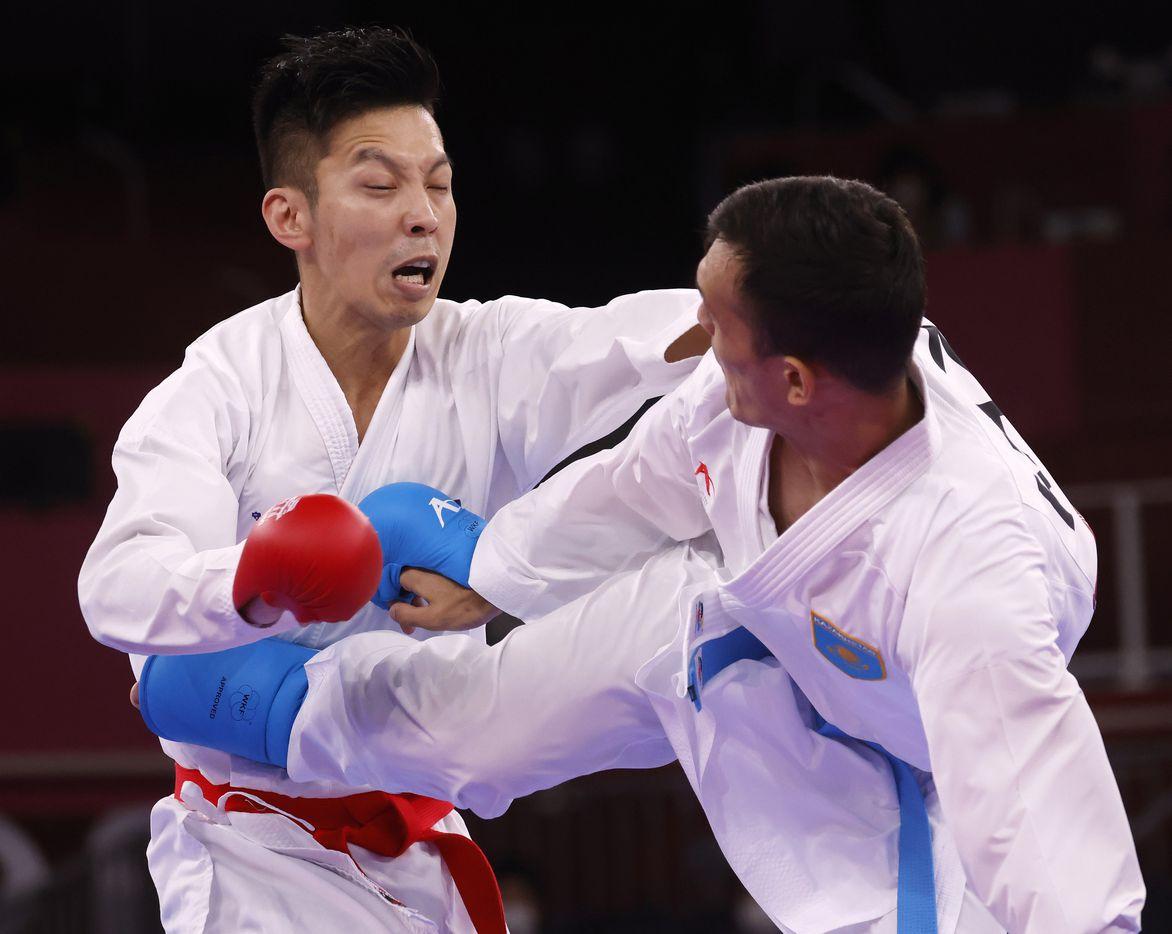 Kazakhstan's Nurkanat Azhikanov kicks Australia's Tsuneari Yahiro in the torso during the karate men's kumite -75kg elimination round at the postponed 2020 Tokyo Olympics at Nippon Budokan, on Friday, August 6, 2021, in Tokyo, Japan. Azhikanov defeated Yahoo 6-3. (Vernon Bryant/The Dallas Morning News)
