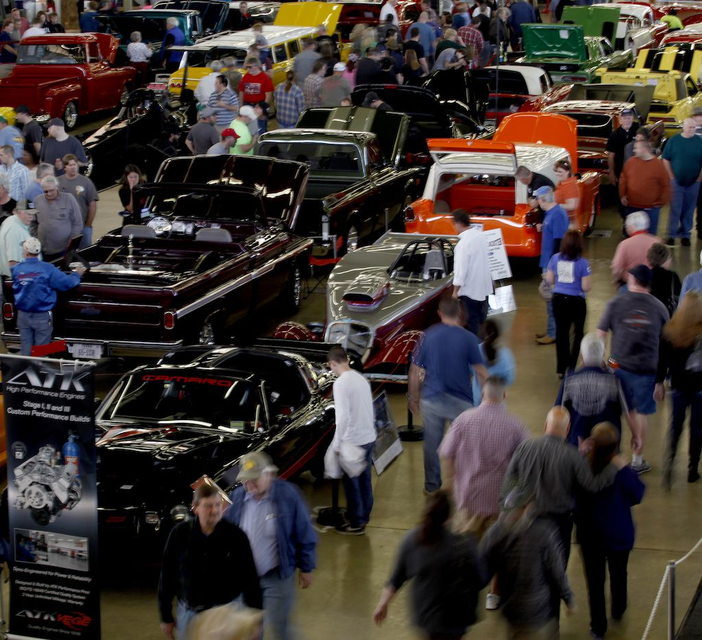People look at the cars on display during the 54th annual O'Reilly Auto Parts AutoRama on February 15, 2014 at Dallas Market Hall in Dallas.