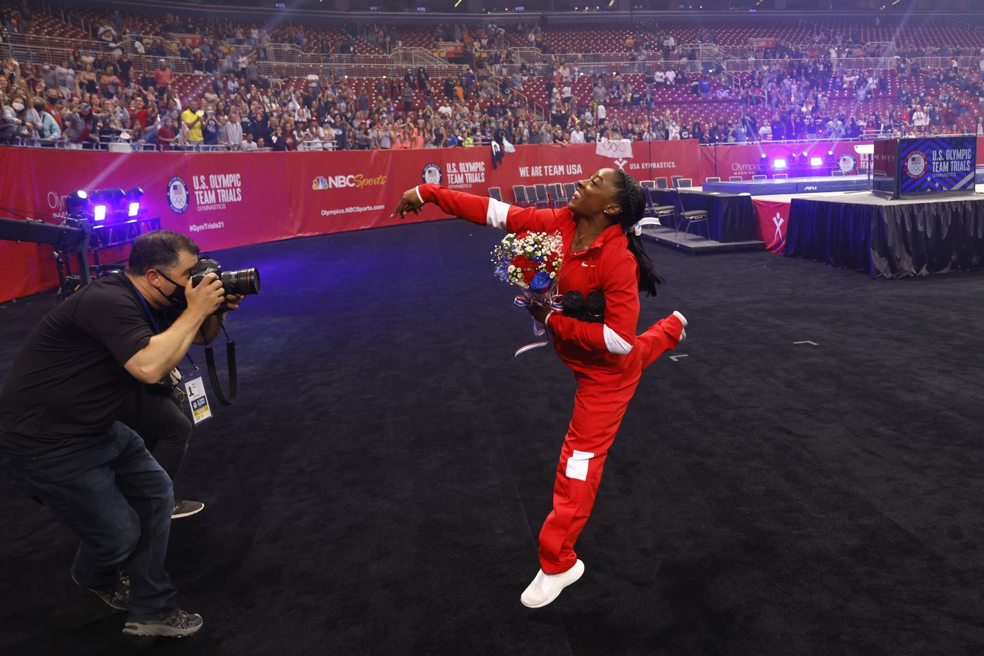Simone Biles tosses a shirt in the stands after team introductions on day 2 of the women's 2021 U.S. Olympic Trials at The Dome at America's Center on Sunday, June 27, 2021 in St Louis, Missouri.(Vernon Bryant/The Dallas Morning News)