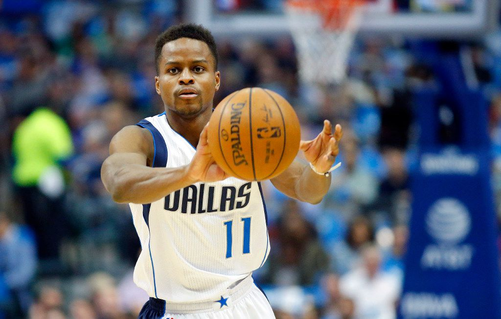 Dallas Mavericks guard Yogi Ferrell (11)  passes the ball against the Portland Trail Blazers in the first half at the American Airlines Center in Dallas, Tuesday, February 7, 2017. (Tom Fox/The Dallas Morning News)