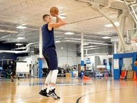 Dallas Mavericks power forward Kristaps Porzingis shoots baskets during the first mandatory workout on July 1, 2020. Porzingis and others played at the team's practice facility for the first time since the coronavirus pandemic started in Dallas, Tex.  (Photo courtesy Dallas Mavericks)