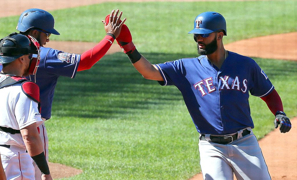 BOSTON, MA - JUNE 12: Nomar Mazara #30 and Elvis Andrus #1 of the Texas Rangers celebrate after scoring on a double by Hunter Pence #24 of the Texas Rangers in the first inning against Boston Red Sox at Fenway Park on June 12, 2019 in Boston, Massachusetts. (Photo by Jim Rogash/Getty Images)