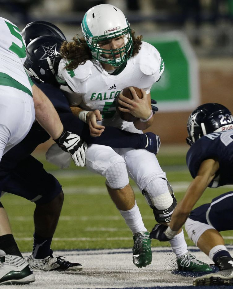 Lake Dallas Falcons Dagan Haehn is tackled by Frisco Lone Star Rangers players in the 3rd quarter as Lake Dallas faces Frisco Lone Star at Eagle Stadium in Allen on Friday, Dec. 11, 2015. (Rachel Woolf/The Dallas Morning News)
