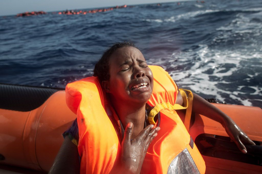 A woman cries after losing her baby in the water as she sits in a rescue boat from the Migrant Offshore Aid Station (MOAS) 'Phoenix' vessel on May 24, 2017 off Lampedusa, Italy. The Migrant Offshore Aid Station  'Phoenix' vessel rescued 603 people after one of three wooden boats partially capsized leaving more than 30 people dead.  (Photo by Chris McGrath/Getty Images)