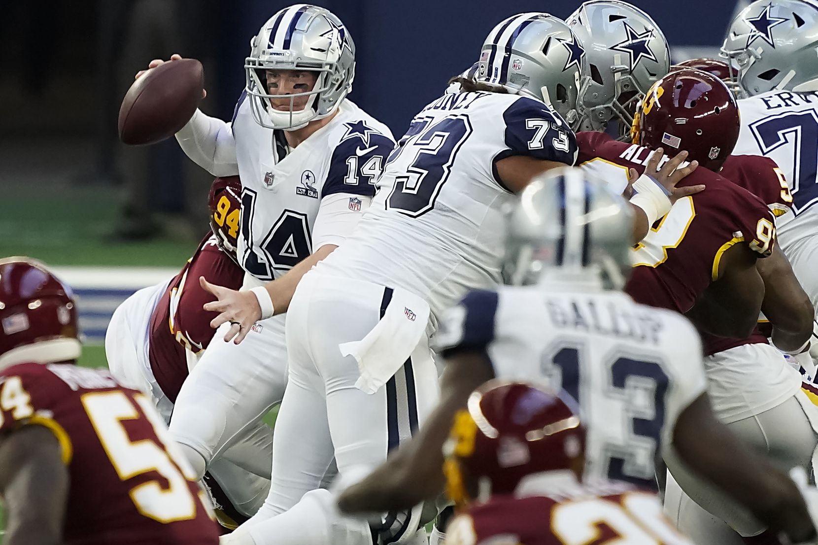 Dallas Cowboys quarterback Andy Dalton (14) looks to pass against the Washington Football Team pass rush during the first quarter of an NFL football game at AT&T Stadium on Thursday, Nov. 26, 2020, in Arlington. (Smiley N. Pool/The Dallas Morning News)