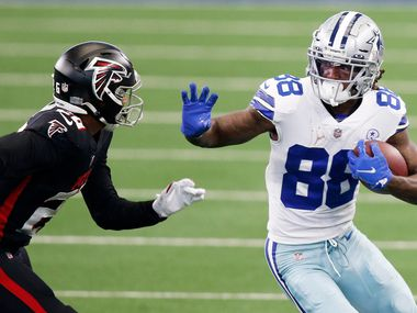 Dallas Cowboys wide receiver CeeDee Lamb (88) attempts to break away from Atlanta Falcons cornerback Isaiah Oliver (26) during second half of play at AT&T Stadium in Arlington, Texas on Sunday, September 20, 2020.