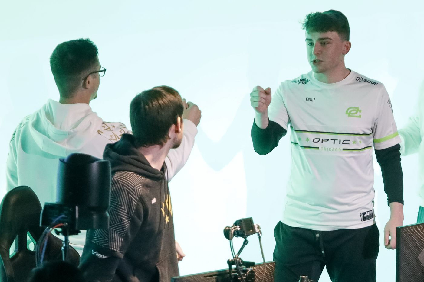 """Dylan """"Envoy"""" Hannon of Chicago OpTic (right) greets Dallas Empire head coach Raymond """"Rambo"""" Lussier (left) after a match during the Call of Duty League Major V tournament at Esports Stadium Arlington on Sunday, Aug. 1, 2021, in Arlington. Empire finished 4th in the tournament after a 3-1 loss to OpTic. (Elias Valverde II/The Dallas Morning News)"""
