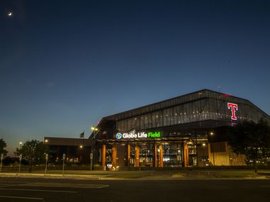 An adjacent parking lot sits empty by Globe Life Field during the opening day game of the Texas Rangers season at Texas Live! in Arlington, Texas, on Friday, July 24, 2020. The Rangers played the Colorado Rockies at the new Globe Life Field stadium, but fans had to watch on televised screens outside due to the ongoing pandemic.