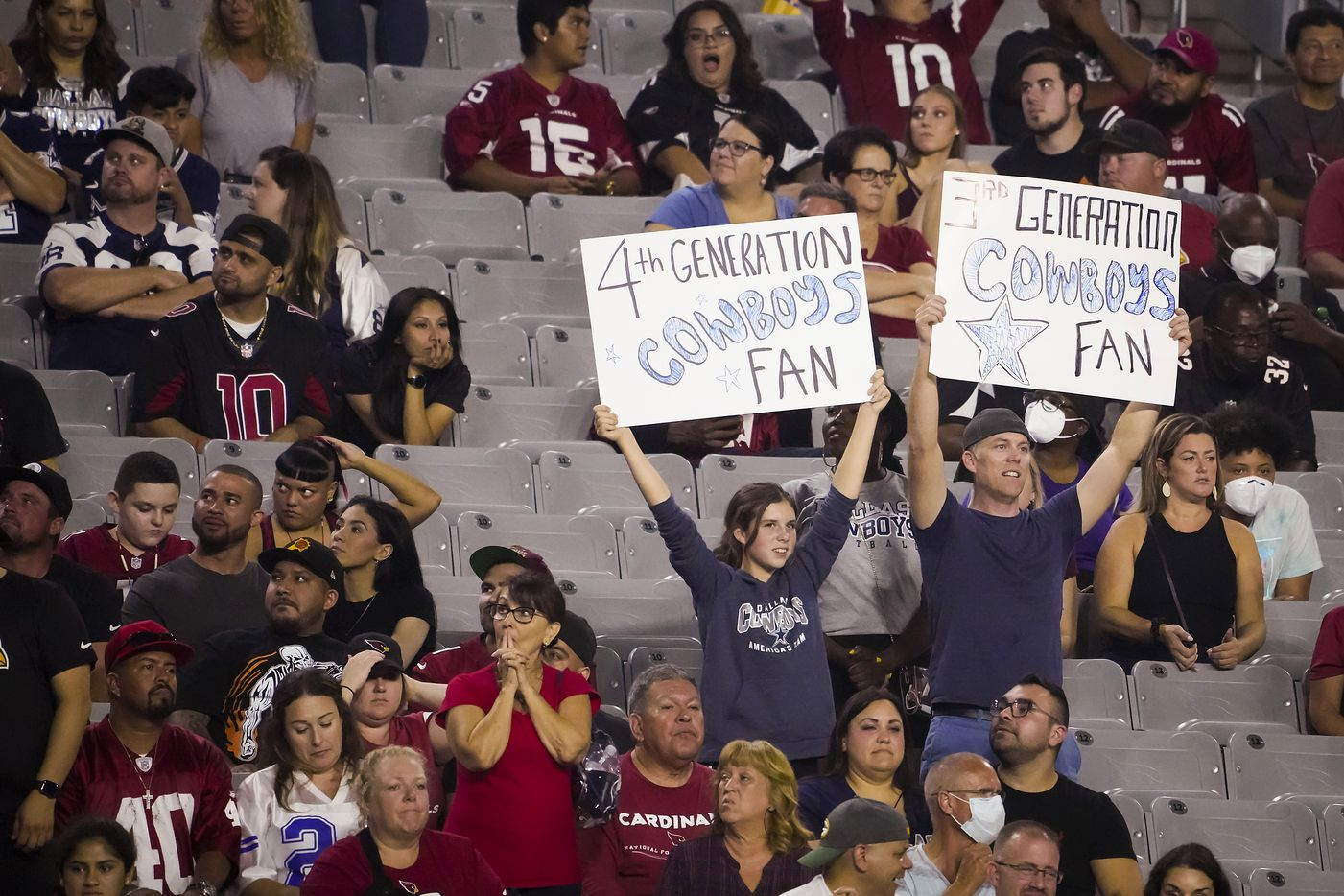 Dallas Cowboys fans cheer their team during the second half of a preseason NFL football game against the Arizona Cardinals at State Farm Stadium on Friday, Aug. 13, 2021, in Glendale, Ariz.