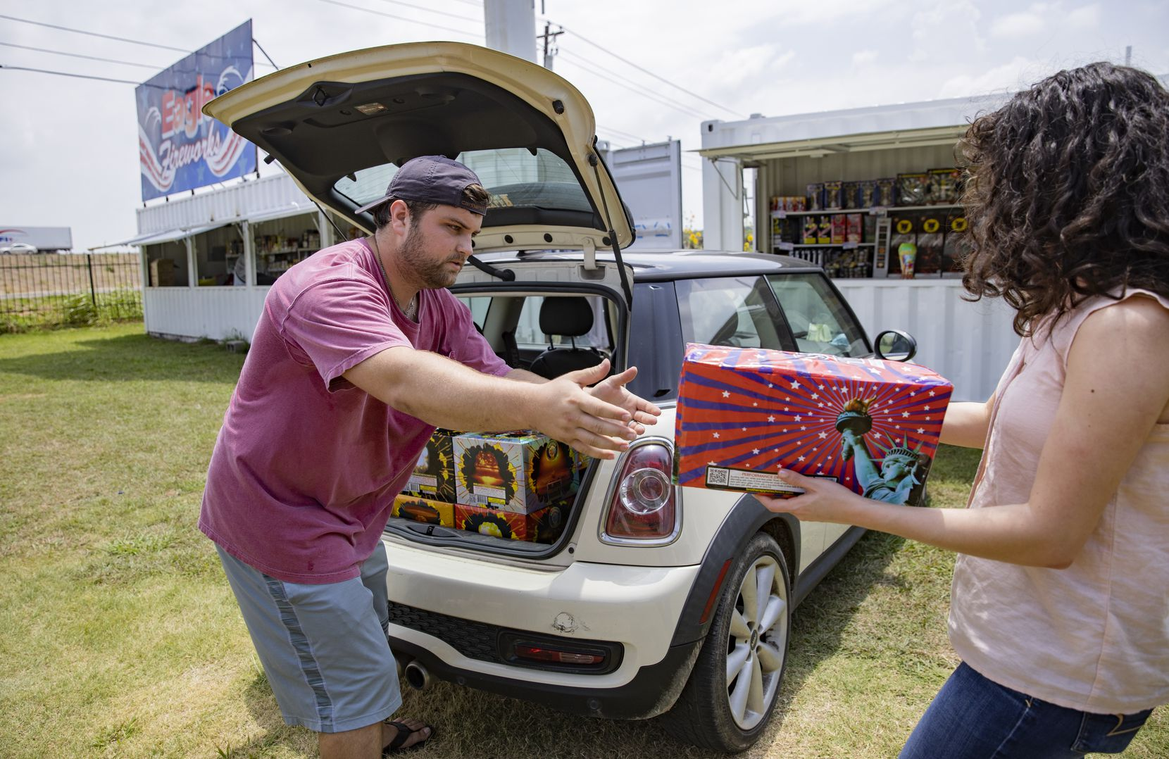 Brock Rodgers of Eagle Fireworks in Midlothian helped Madeline Small load a purchase into her car on Thursday.