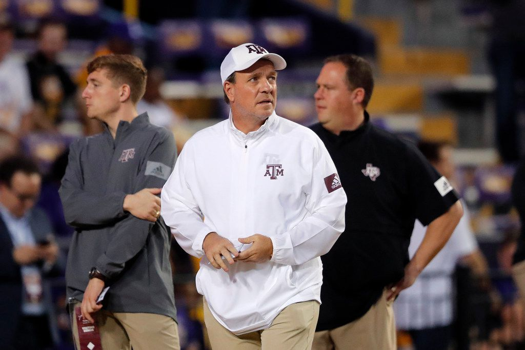 Texas A&M head coach Jimbo Fisher walks on the field before an NCAA college football game against LSU in Baton Rouge, La., Saturday, Nov. 30, 2019. (AP Photo/Gerald Herbert)