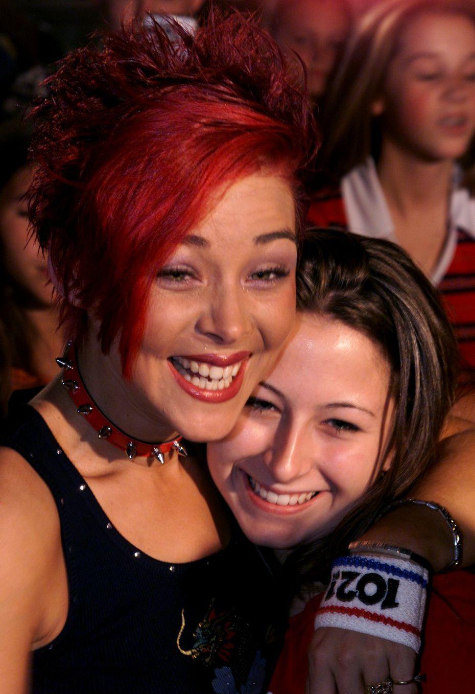 Nikki McKibbin, left, hugs her friend Deana Hale at Rack Daddy's in Arlington.