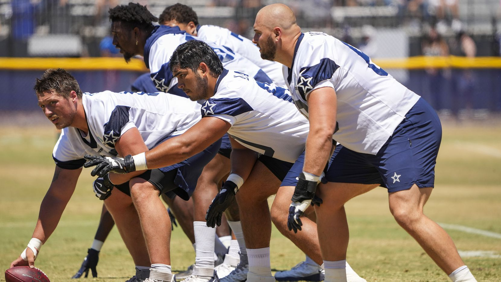 Dallas Cowboys tackle Isaac Alarcón (center) lines up with teammates during a practice at training camp on Tuesday, Aug. 3, 2021, in Oxnard, Calif.