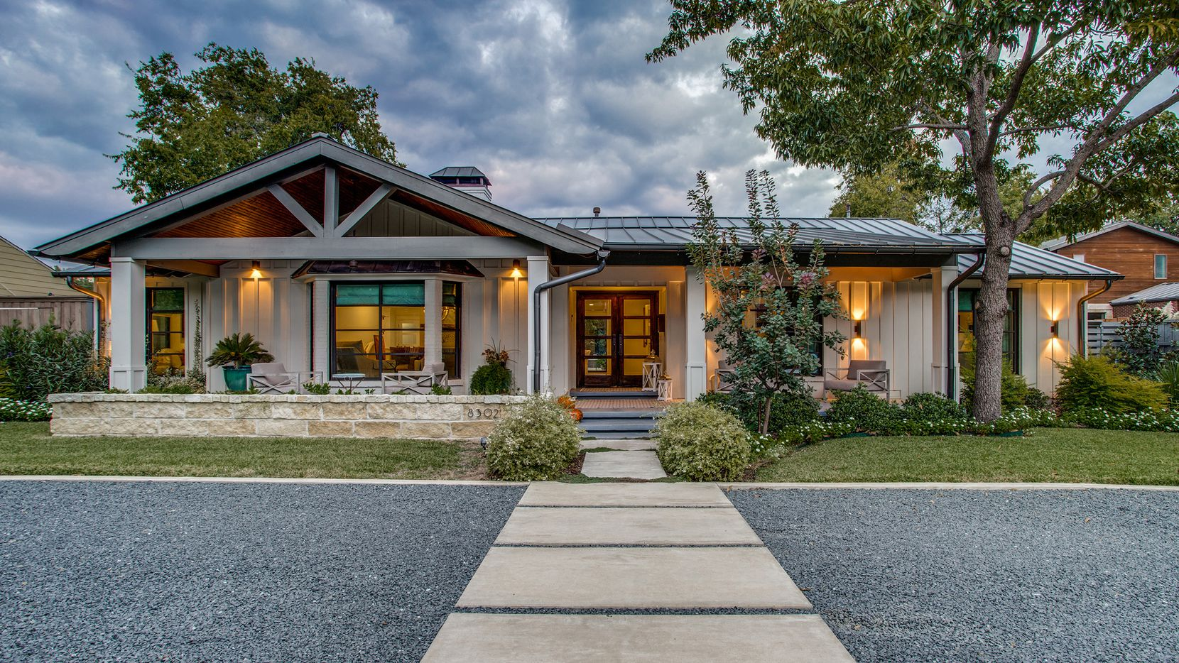 The updated home at 8302 Midway Road offers five bedrooms, a stone fireplace, game and media rooms and a pool.
