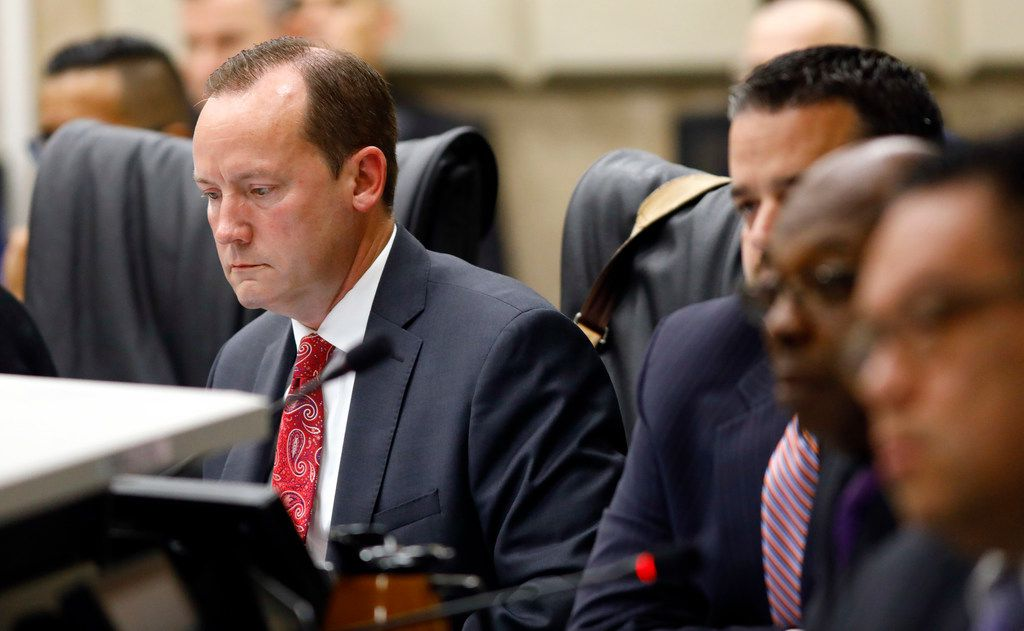 Dallas City Council member Philip Kingston looks at his computer as others members listen to Dallas County Commissioner John Wiley Price speak about race before a council meeting.