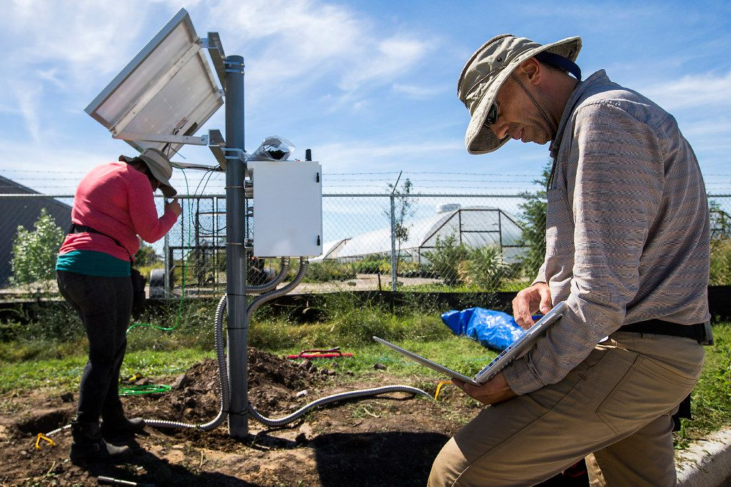Alexandros Savvaidis, program manager for TexNet, checks his laptop as he and an associate install a portable seismometer behind a fire station on Sept. 29, 2016, in Farmers Branch, Texas. TexNet is an earthquake monitoring program run by the Bureau of Economic Geology, at the University of Texas at Austin, to help locate and determine the origins of earthquakes in Texas.