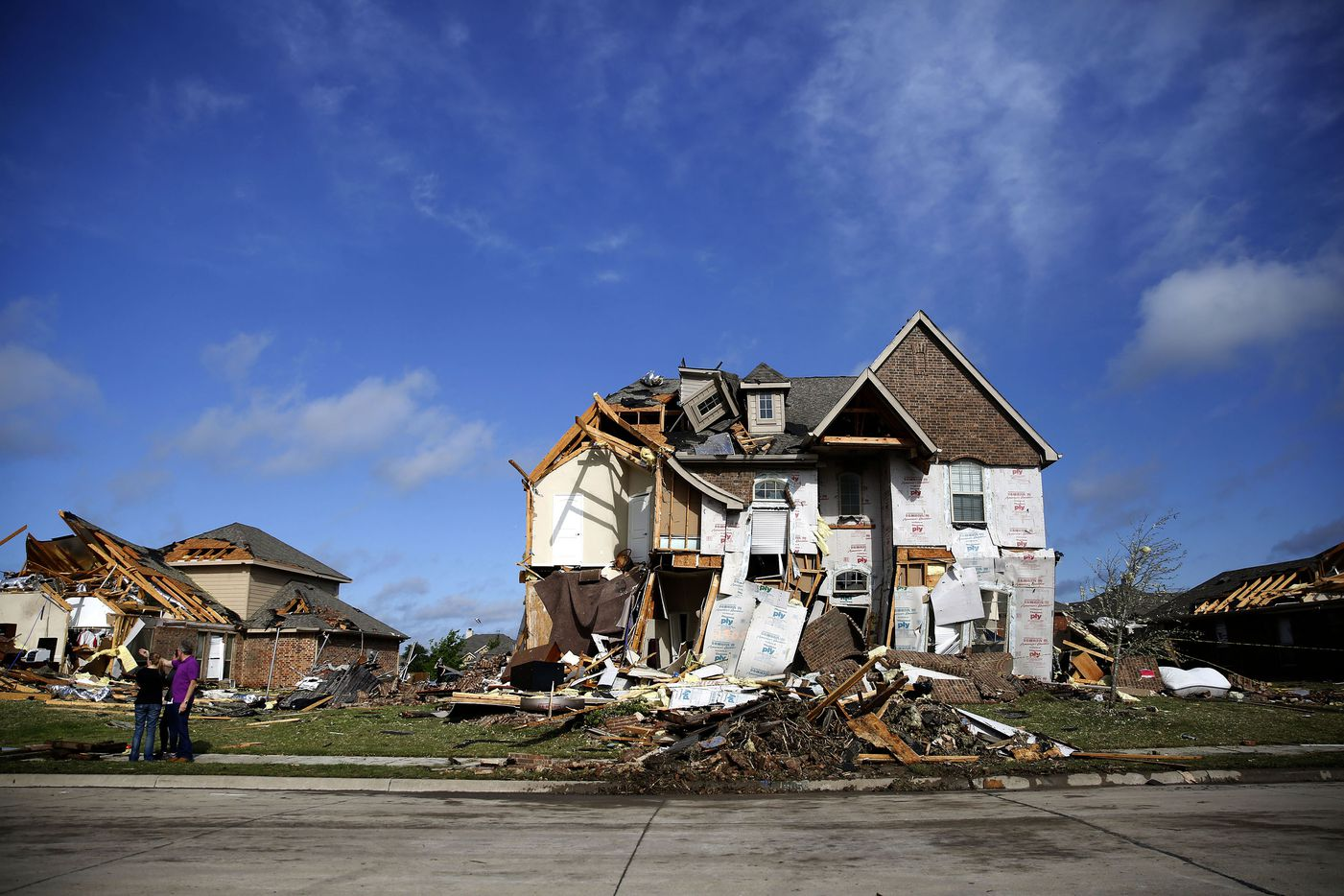 Damaged homes along Panhandle Drive following a storm in the early hours of the morning in Rockwall, Texas on Wednesday, March 29, 2017. (Rose Baca/The Dallas Morning News)