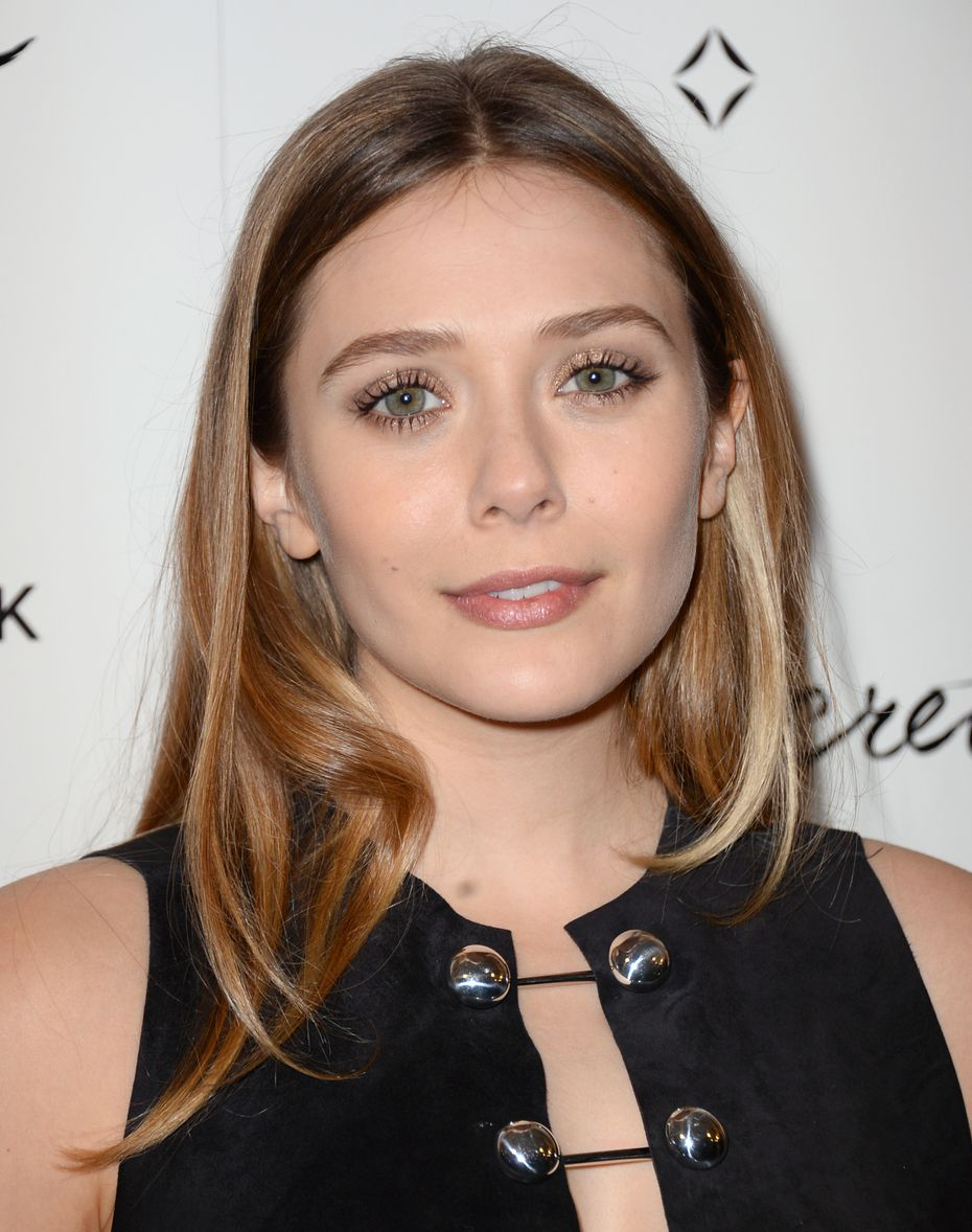Elizabeth Olsen arrives at a Los Angeles movie premiere in 2014.