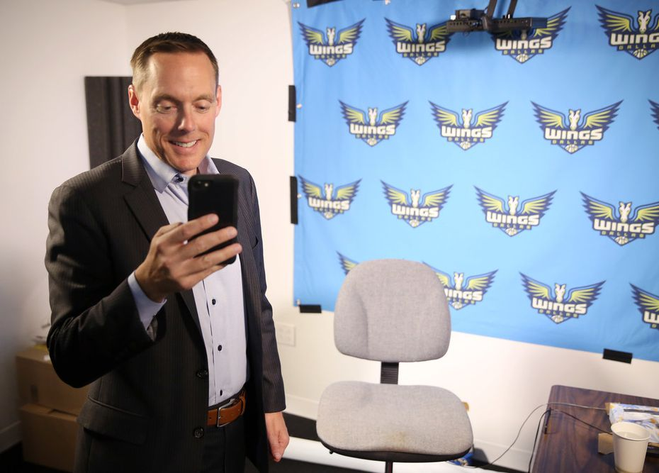 Dallas Wings general manager Greg Bibb tells his son what pick the Wings received via FaceTime call after participating in the WNBA lottery at The Dallas Morning News studio in Dallas on Tuesday, September 17, 2019. The Wings have the second pick in the 2020 WNBA draft.(Vernon Bryant/The Dallas Morning News)