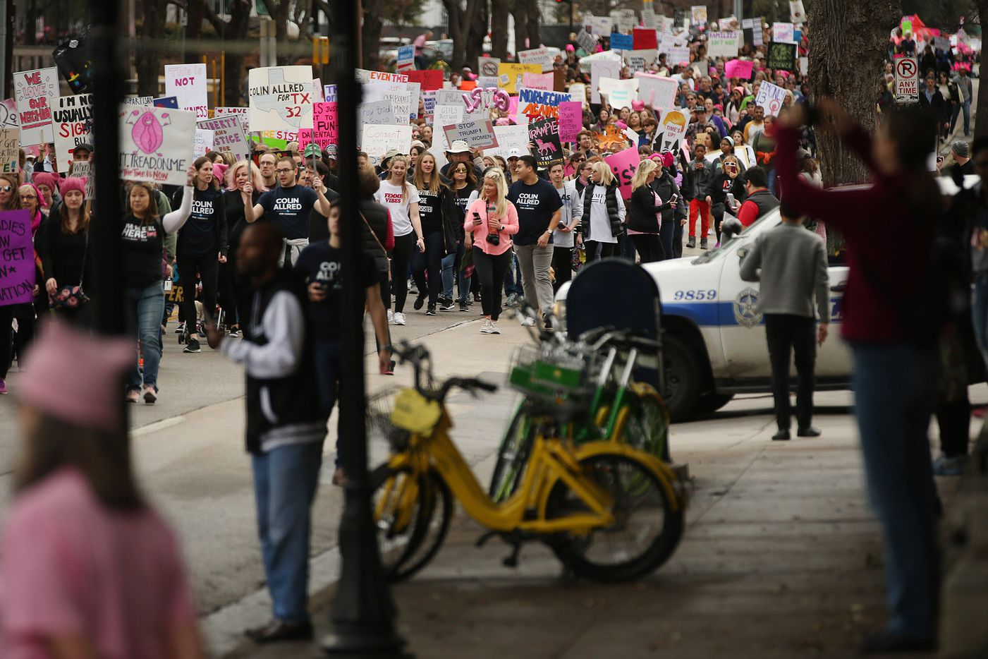 Marchers move Uptown during the Dallas Women's March in Dallas Saturday.