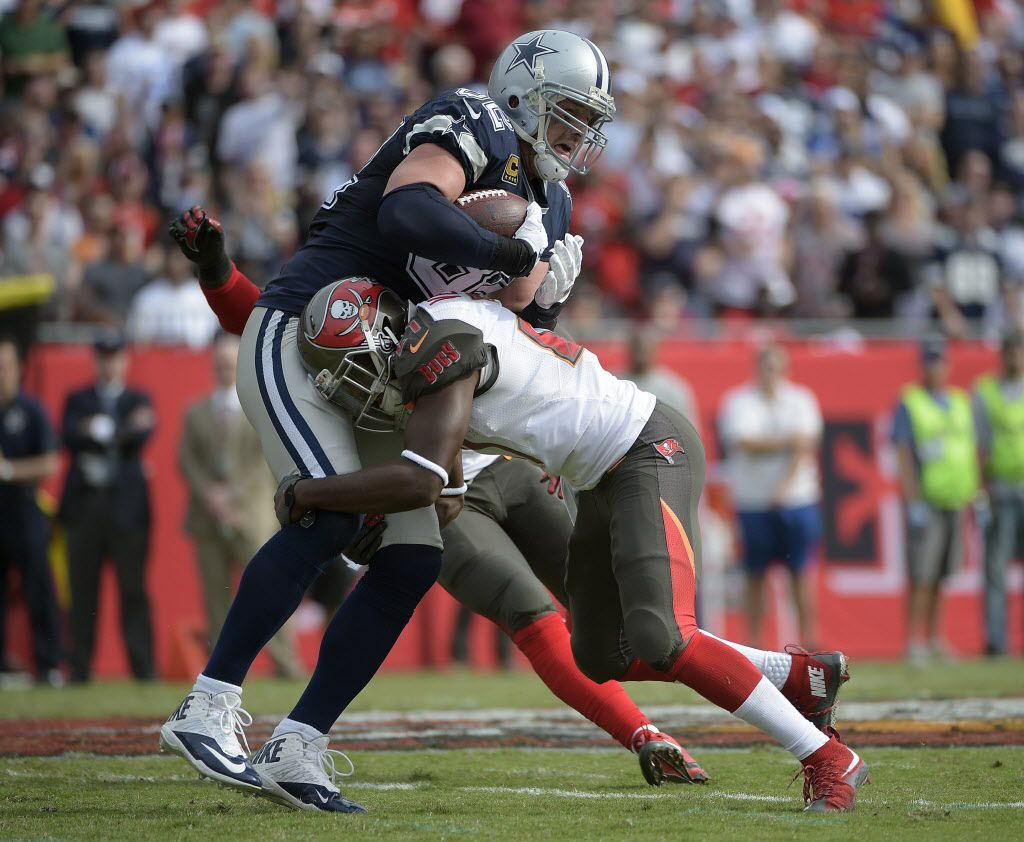 Tampa Bay Buccaneers cornerback Alterraun Verner (21) stops Dallas Cowboys tight end Jason Witten (82) during the second quarter of an NFL football game Sunday, Nov. 15, 2015, in Tampa, Fla. (AP Photo/Phelan M. Ebenhack)