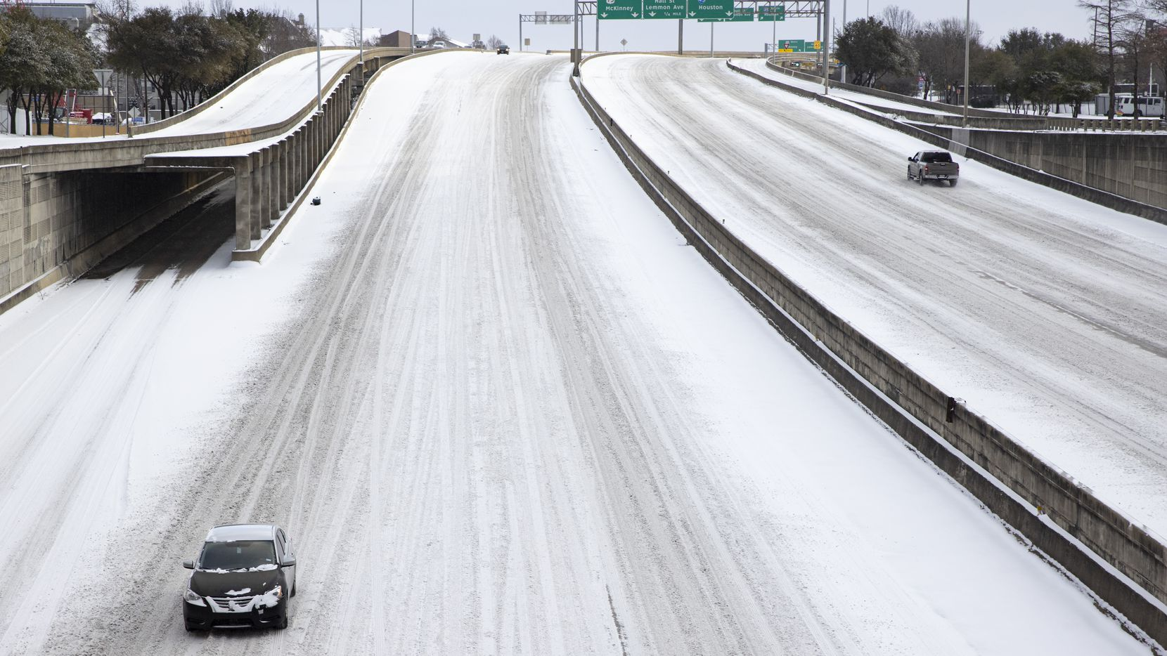 Snow covers Woodall Rodgers Freeway in Downtown Dallas. Severe winter weather wreaked havoc on infrastructure, from roads to water treatment plants, across North Texas.