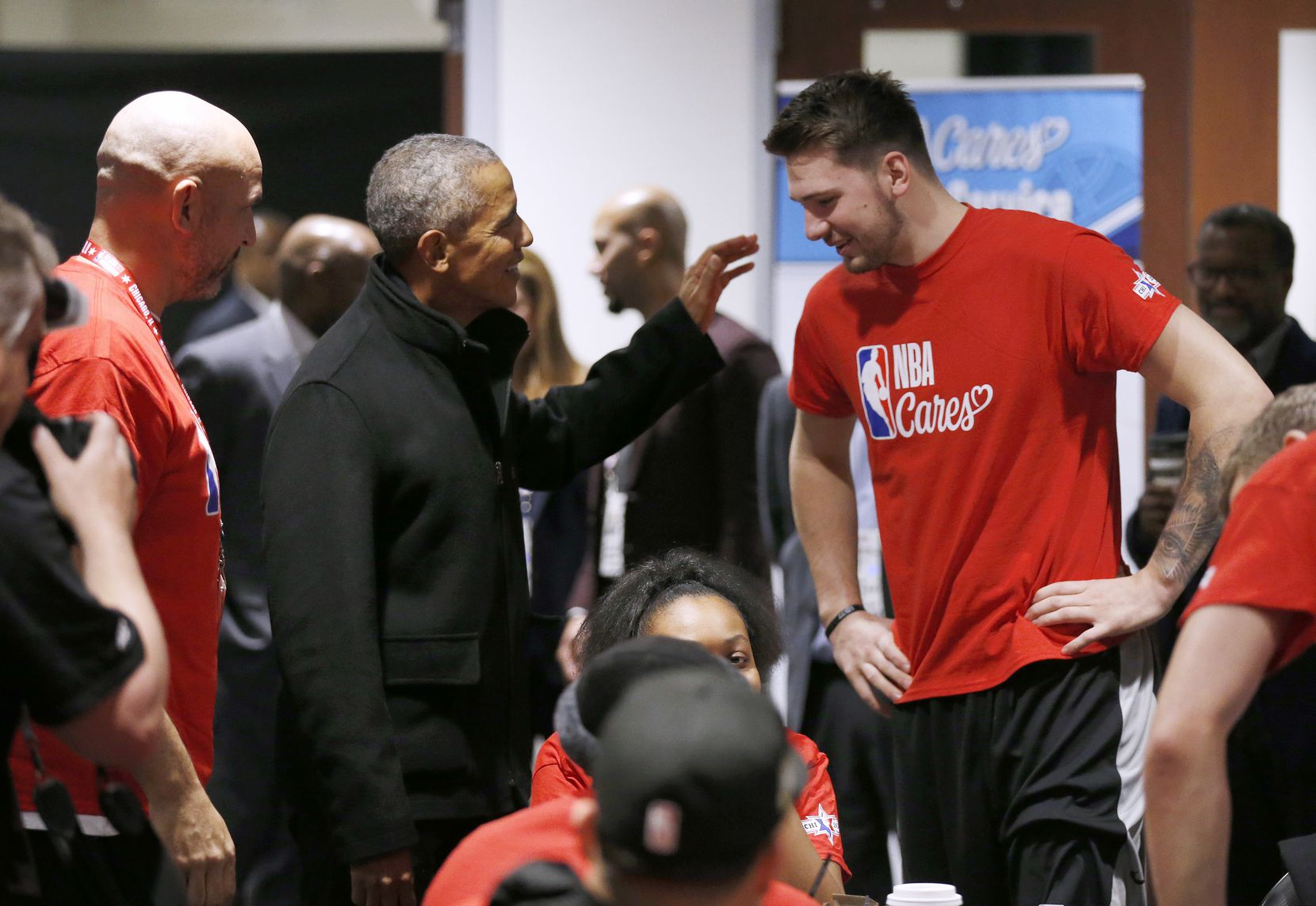 Former President Barack Obama jokes with Los Angeles Lakers assistant coach Jason Kidd as he talks with Dallas Mavericks forward Luka Doncic (77) during a NBA Cares Day of Service event during NBA All Star 2020 at Wintrust Arena in Chicago on Friday, February 14, 2020.