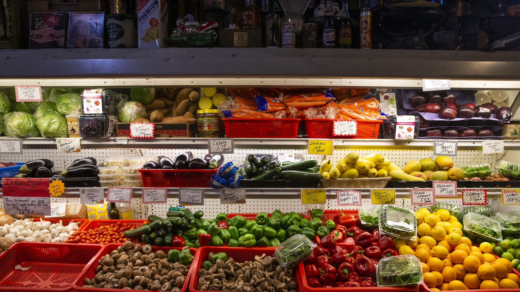 The produce aisle at Jimmy's Food Store in Old East Dallas on April 22, 2020. Fewer customers are visiting the store due to the coronavirus pandemic, but they're buying more groceries when they visit, co-owner Paul DiCarlo said. All employees are wearing masks, sanitizing surfaces often and practicing social distancing to keep themselves and customers safe.