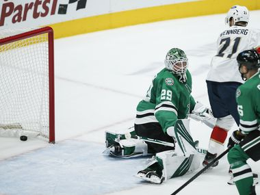 Florida Panthers forward Alex Wennberg (21) screens Dallas Stars goaltender Jake Oettinger (29) allowing Florida Panthers forward Jonathan Huberdeau to score during the first period of an NHL hockey game in Dallas, Sunday, March 28, 2021.