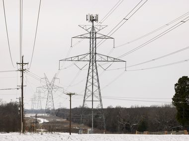 Large electrical transmission lines cross through South Arlington, Texas, on Feb. 17, 2021. Rolling power outages disrupted service to customers following snow storms.  (Tom Fox/The Dallas Morning News)