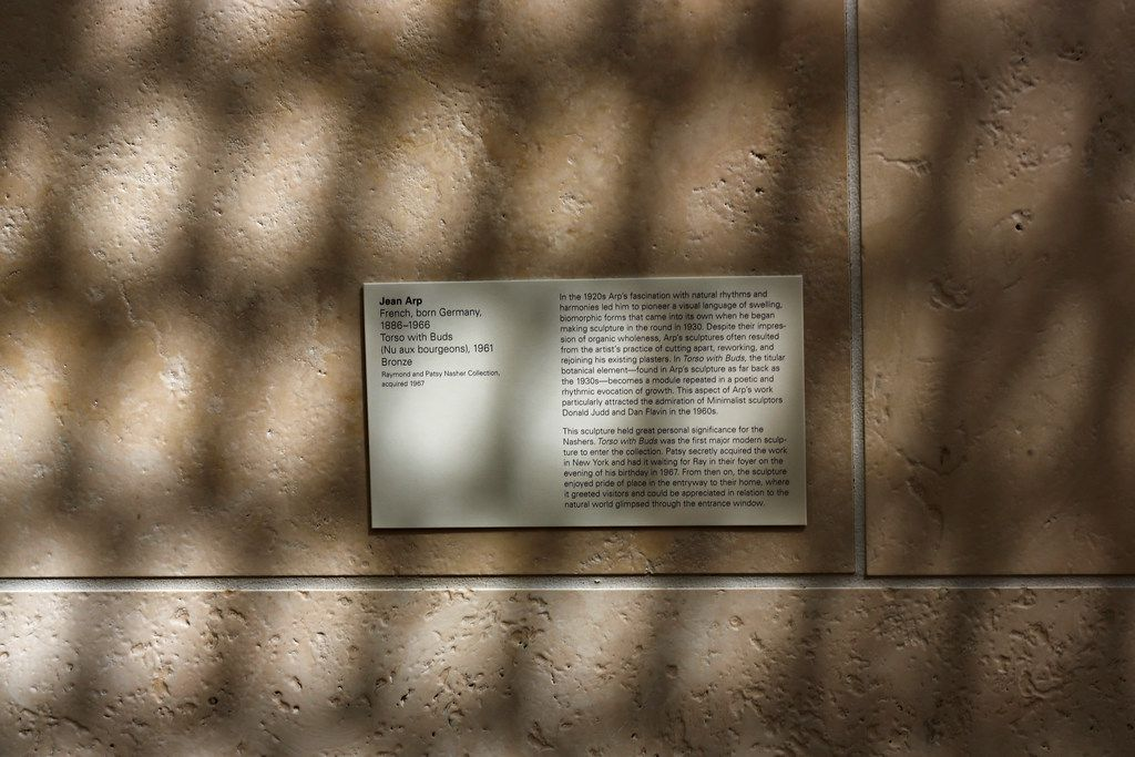 Shadows fall on the nameplate of a work of Jean Arp, as the reflected light off of Museum Tower casts shadows in the galleries at the Nasher Sculpture Center in Dallas, photographed in downtown Dallas on Aug. 17, 2018.