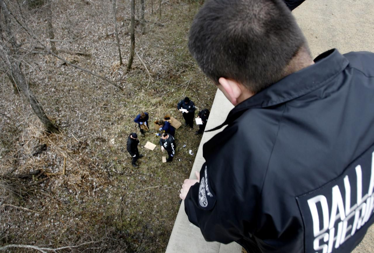 A Dallas County sheriff's deputy  watched a forensics team collect evidence where the bodies of Luis Campos and Linoshka Torres were found off Dowdy Ferry Road in 2007.
