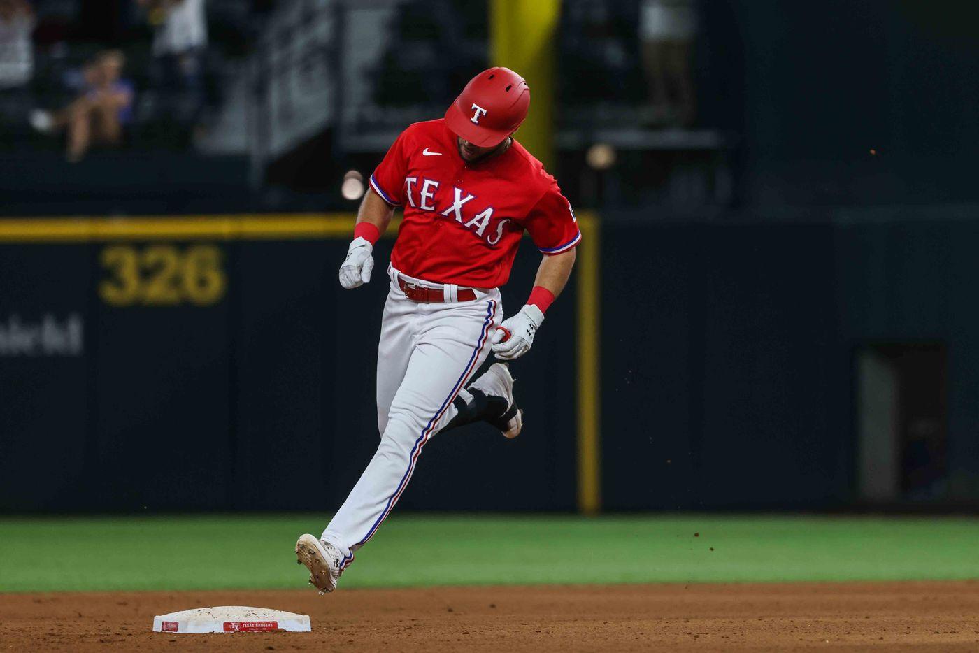 Texas Rangers Jason Martin (50) runs the bases after his home run in the seventh inning at Globe Life Field in Arlington, Texas, Friday, July 30, 2021. Seattle 8, Rangers 5. (Lola Gomez/The Dallas Morning News)
