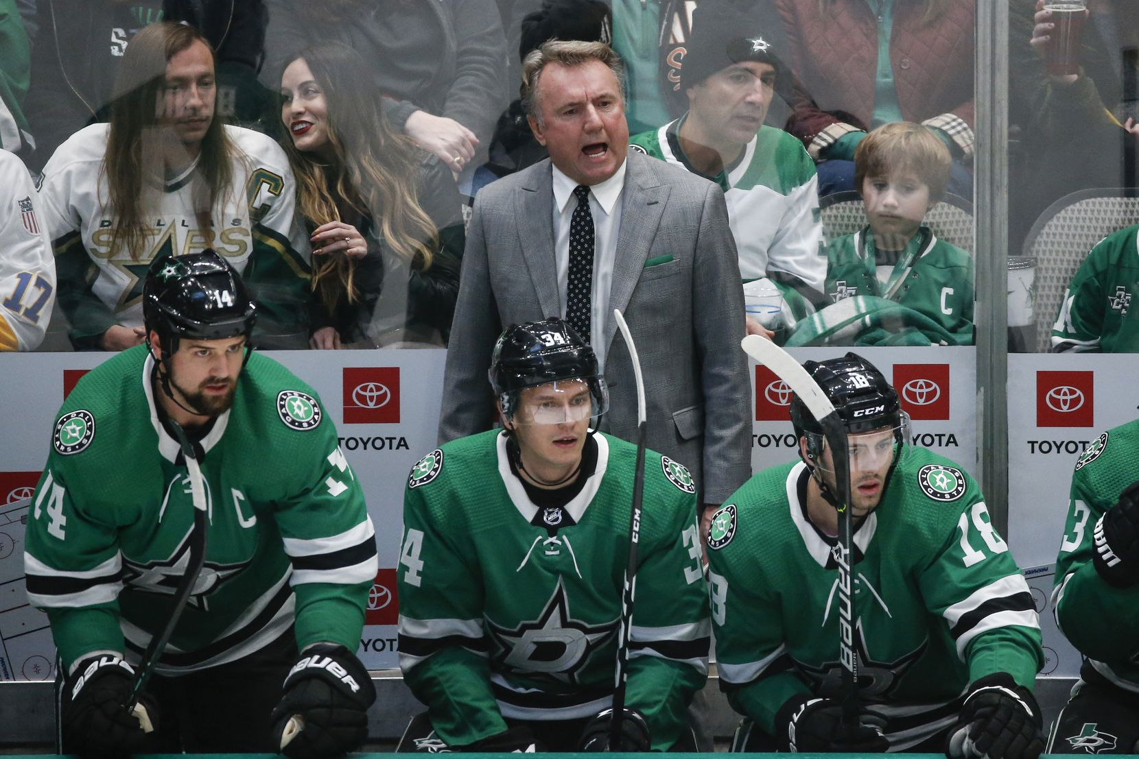 "Dallas Stars interim head coach Rick Bowness works the bench during the first period of a National Hockey League match between the Dallas Stars and the New Jersey Devils on Tuesday, Dec. 10, 2019 at American Airlines Center in Dallas. The Stars fired coach Jim Montgomery for ""unprofessional conduct"" on Tuesday morning, ending his second season behind the bench. The team failed to disclose exactly why Montgomery was dismissed. (Ryan Michalesko/The Dallas Morning News)"