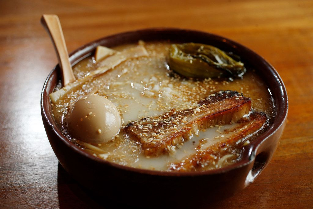 Paitan shio ramen with pork belly chashu, marinated egg and diced white onion