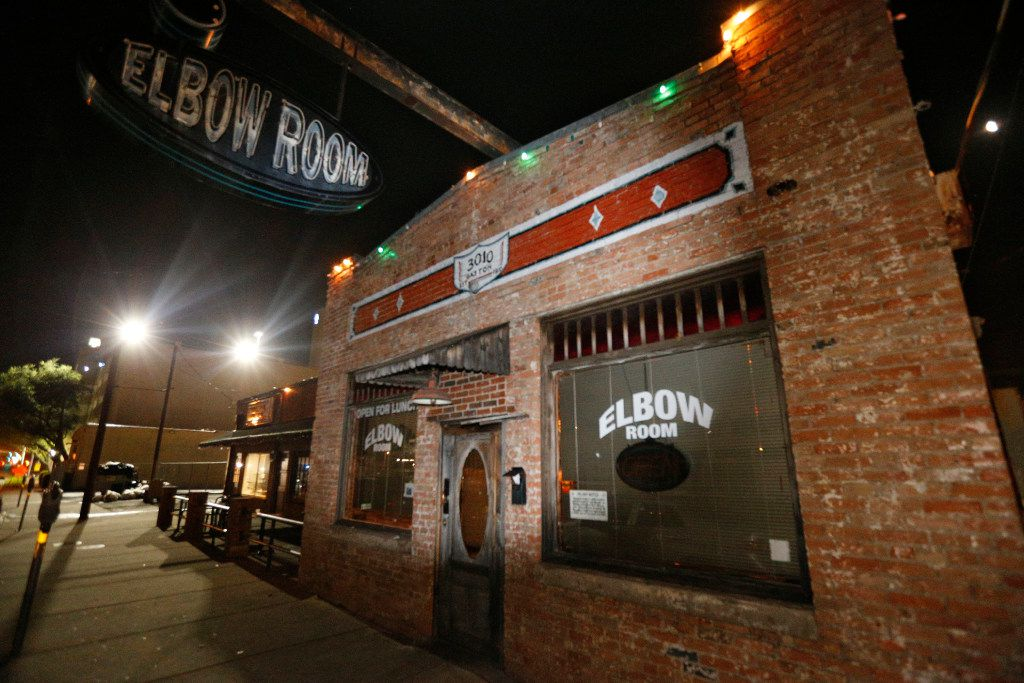 Closing time: The lights went out on the last night of operation at the Elbow Room in East Dallas early Sunday. (Nathan Hunsinger/Staff Photographer)