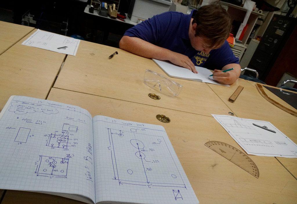 Arlington Lamar robotics team member Timmy Bauer, 17, works on the team's latest robot design after school.