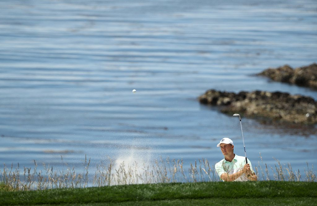 PEBBLE BEACH, CALIFORNIA - JUNE 10: Jordan Spieth of the United States plays a shot from a bunker on the eighth hole during a practice round prior to the 2019 U.S. Open at Pebble Beach Golf Links on June 10, 2019 in Pebble Beach, California. (Photo by Ezra Shaw/Getty Images)