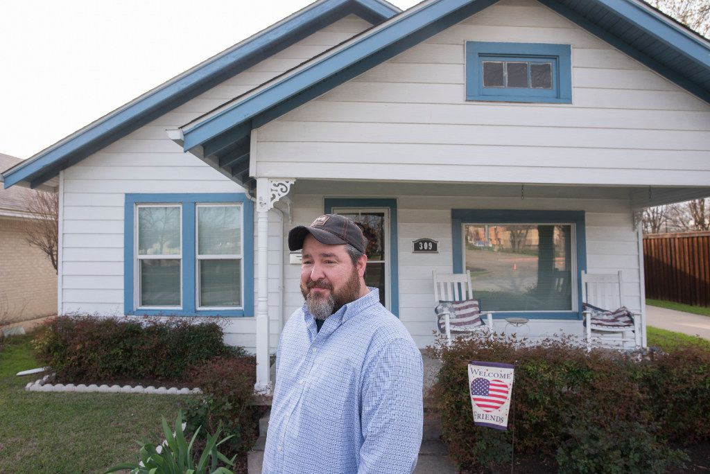 Chris Warden shows off his 1927 Craftsman home on South 11th Street in Garland.  Two blocks of the street backing up to Garland High School have been added to the National Register of Historic Places.
