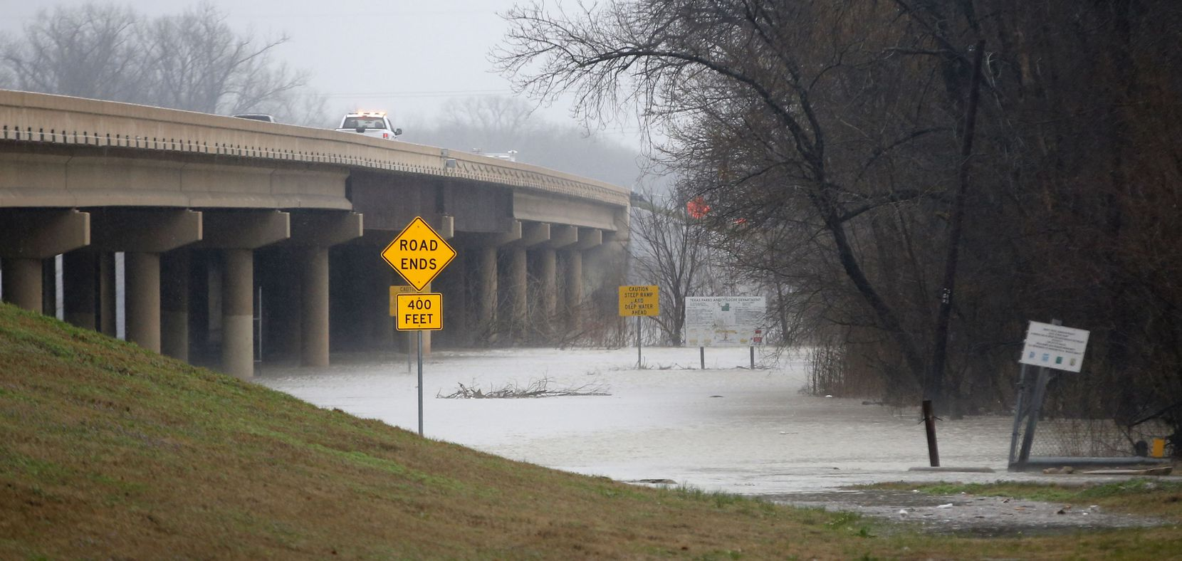 Dallas Fire-Rescue teams respond to a report that a car and person were swept away Wednesday.
