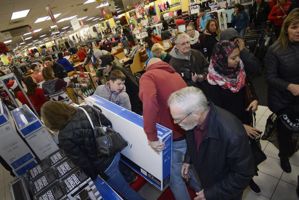 Customers shop at the Northcrest Kohls store in Fort Wayne, Ind,, Thursday, Nov 26, 2015. The store opened at 6 pm on Thanksgiving night with about 200 people in line.