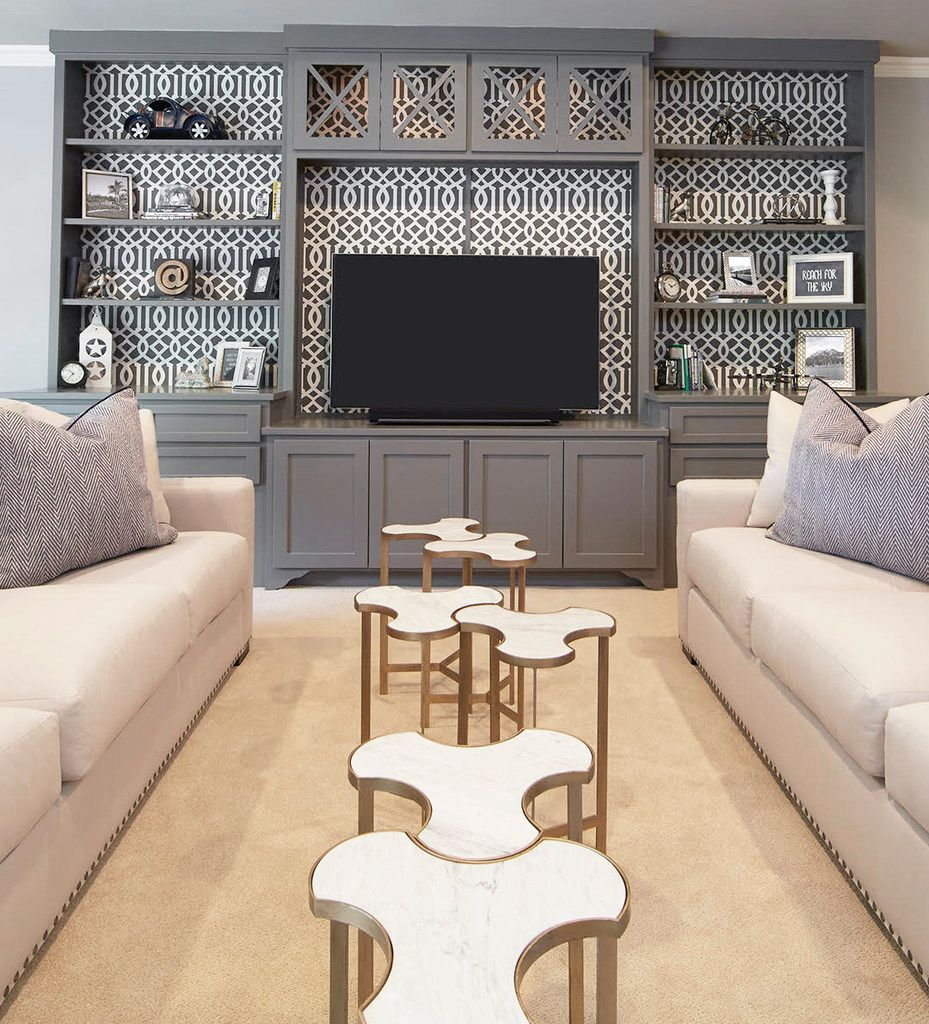 Punch up built-in cabinetry with graphic wallpaper or fabric, suggests Emily Sheehan Hewett of A Well Dressed Home.