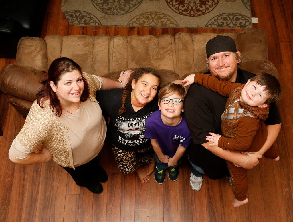 From left: Tommie Ogletree; Sydney Ogletree, 12; Bradley Ogletree, 10; Kelley Ogletree holding Zachary Ogletree, 3, at their home this month in Lewisville. Zachary, who was diagnosed with severe autism as a baby, is one of 8,000 Denton County kids enrolled in the Children's Health Insurance Program.