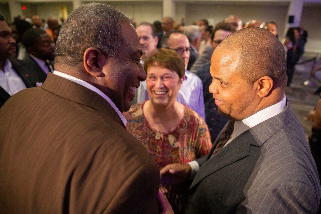 State Sen. Royce West, left, chats with Mayor-elect Eric Johnson after giving remarks during his victory party at Fairmont Dallas on Saturday, June 8, 2019.