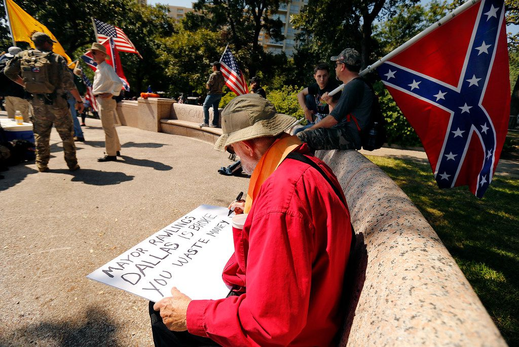 James Murphy of Red Oak creates a protest sign before the This Is Texas Freedom Force protest over removal of the Robert E. Lee statue from Lee Park in Dallas on Sept. 6, 2017.