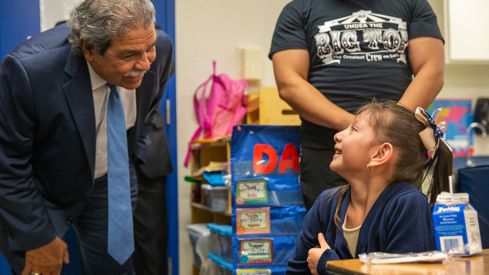 Dallas ISD Superintendent Michael Hinojosa (left) speaks with Juliana Hernandez, 5 (right), at the Martin Luther King Jr. Learning Center in Dallas for the first day of school on Monday, Aug. 19, 2019.