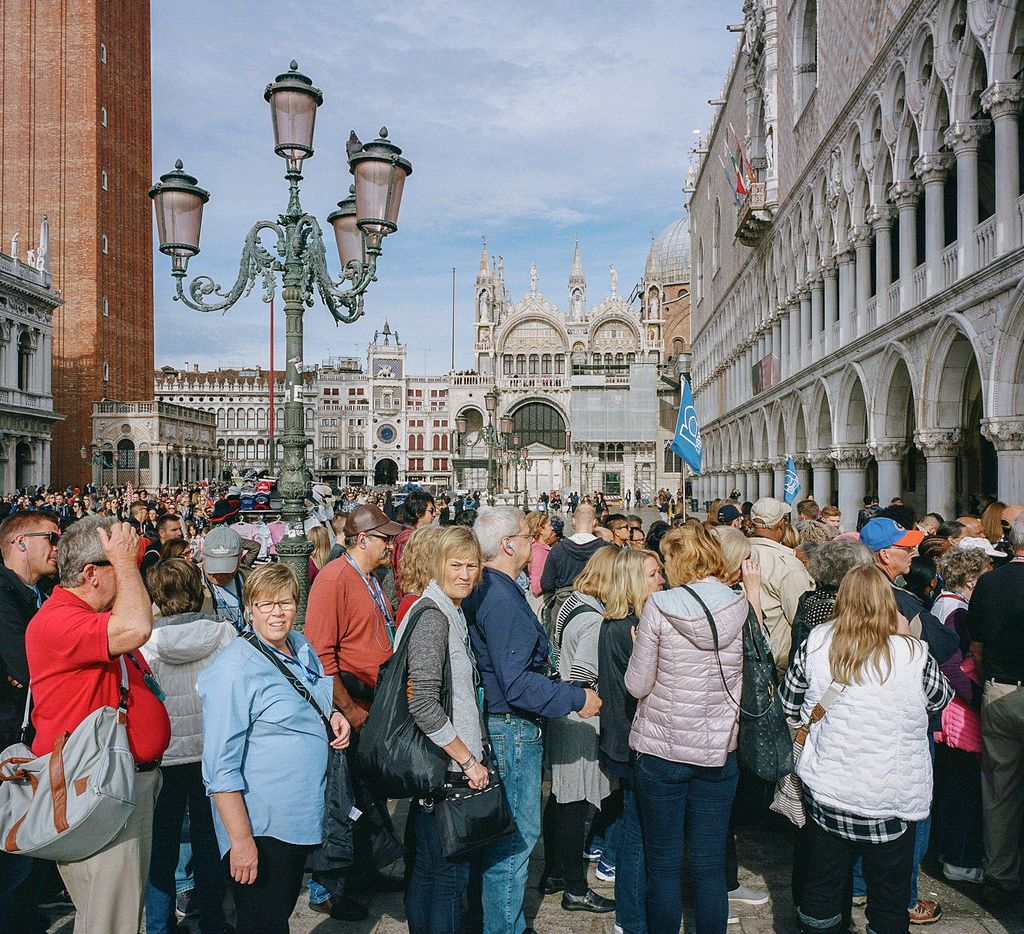 Visitors waited to enter a Tintoretto exhibit at the Palazzo Ducale in Venice in November. The city is straining under the weight of so many tourists.