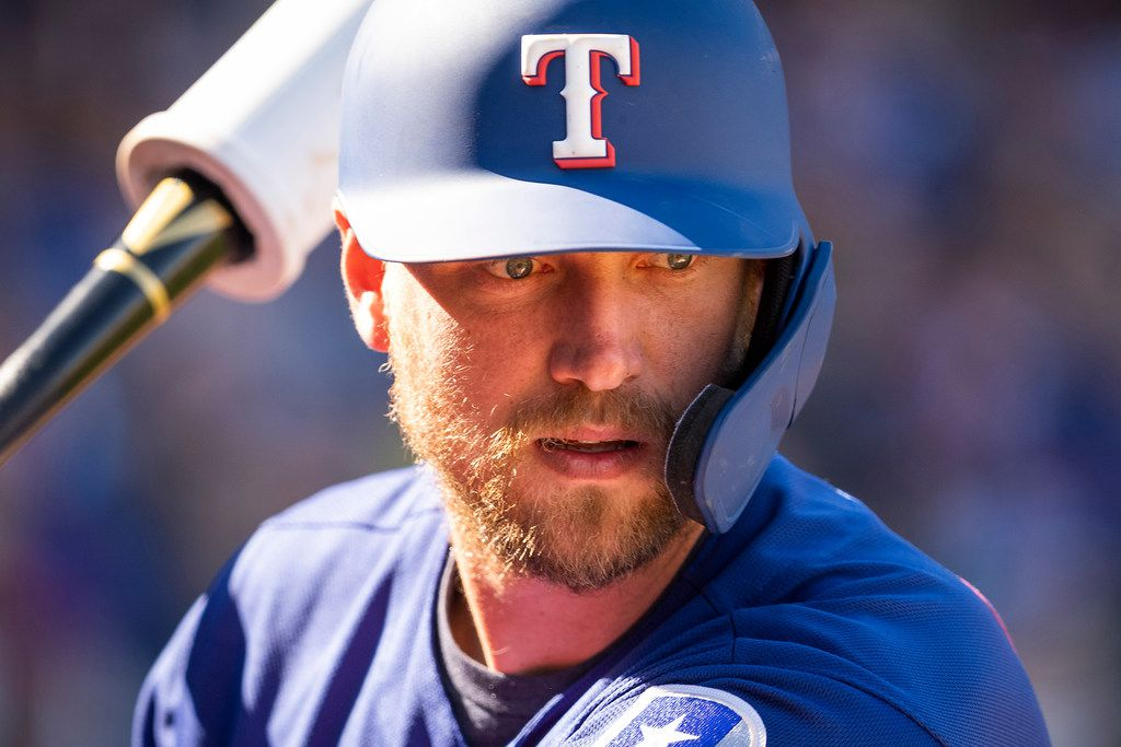 Texas Rangers designated hitter Hunter Pence takes practice swings on deck before hitting during the fifth inning of a spring training baseball game against the Chicago Cubs on Wednesday, Feb. 27, 2019, in Surprise, Ariz.. (Smiley N. Pool/The Dallas Morning News)